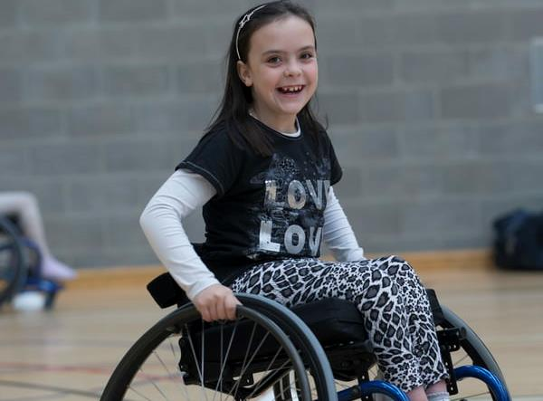 Girl in wheelchair in gym