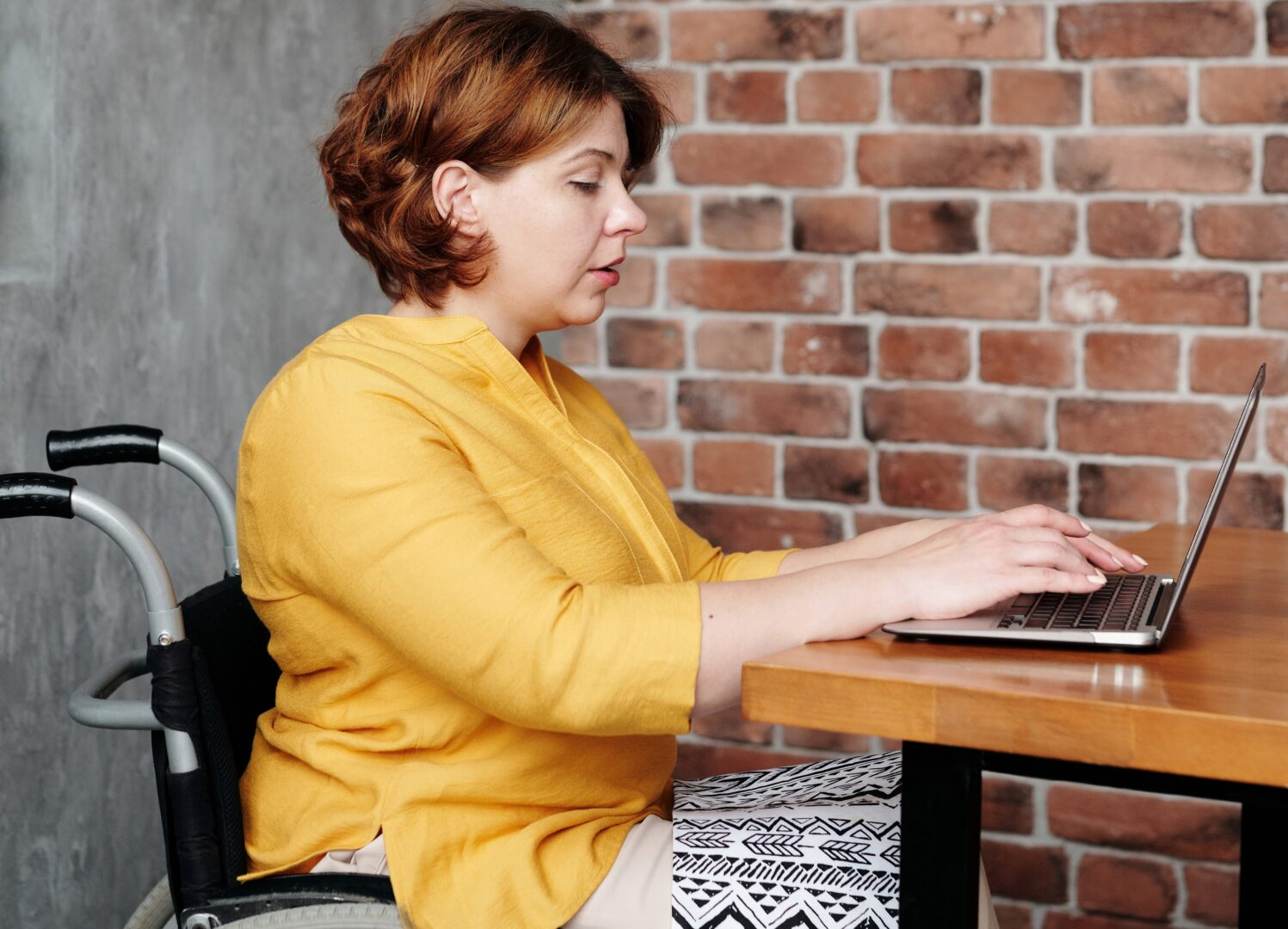 Photo of woman wheelchair user on laptop